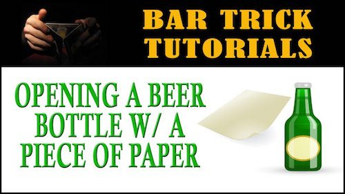 opening beer bottle with piece of paper